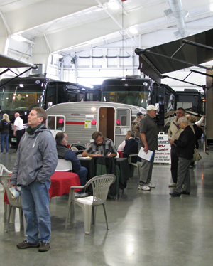 Washington State Evergreen Spring RV Show: Visitors explore the indoor motorhome exhibits in comfort and warmth
